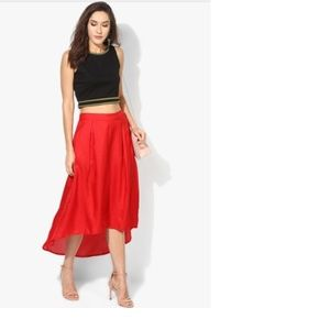 Beautiful solid red skirt with a high-low hem
